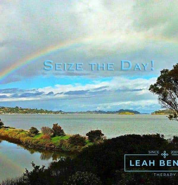 "Color photo of rainbow over San Francisco bay with the words, ""Seize the Day"" LEAH BENSON THERAPY"