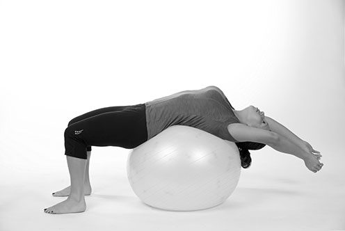 expansive breathing exercise over stability ball - self-care