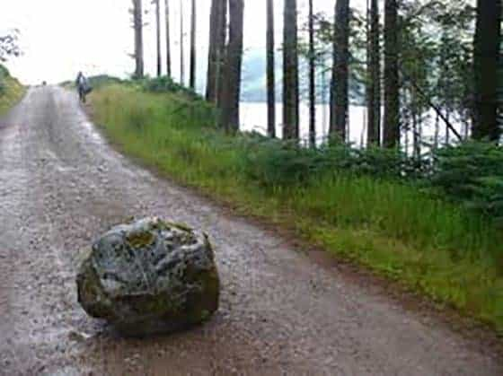 A rock in the middle of a dirt road is the metaphor for blocks to emotional success