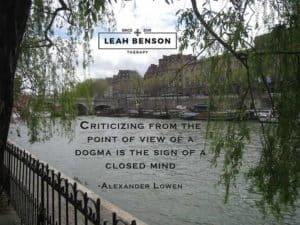 "Photo of Seine River in Paris with boats and a bridge. Quote by Alexander Lowen, ""Criticizing from the point of view of a dogma is the sign of a closed mind"""