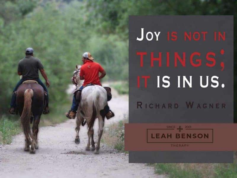 Photo of 2 horsemen on a trail with text,