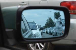 Photo of a traffic jam and side mirror