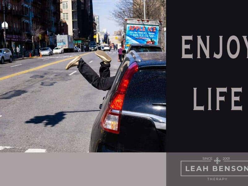 Photo of car and street scene with the words,