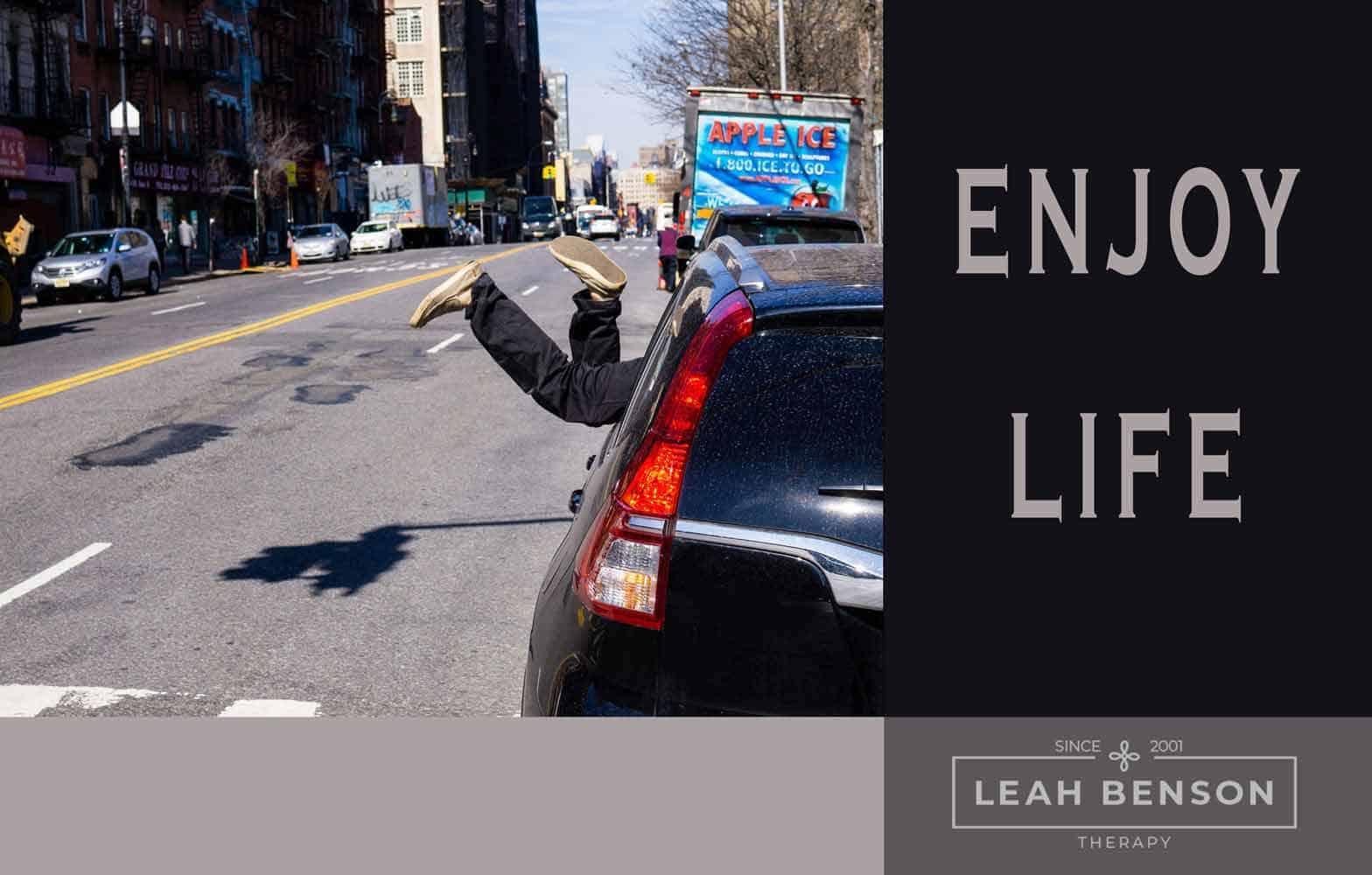 "Photo of car and street scene with the words, ""Enjoy Life"""