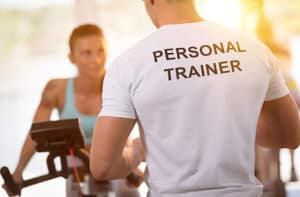 Personal trainer and client