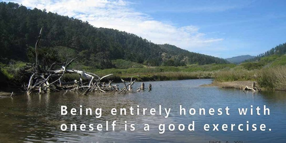 A color photo of mountains and a river with a quote from Freud,