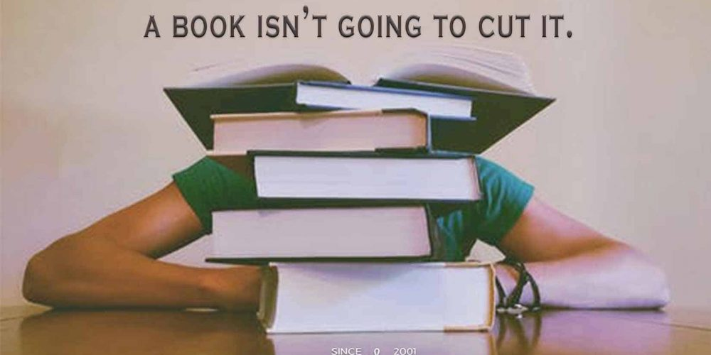 Photo of person sitting behind a stack of books with the quote,