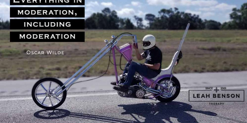 Photo of a guy riding a chopper with text,