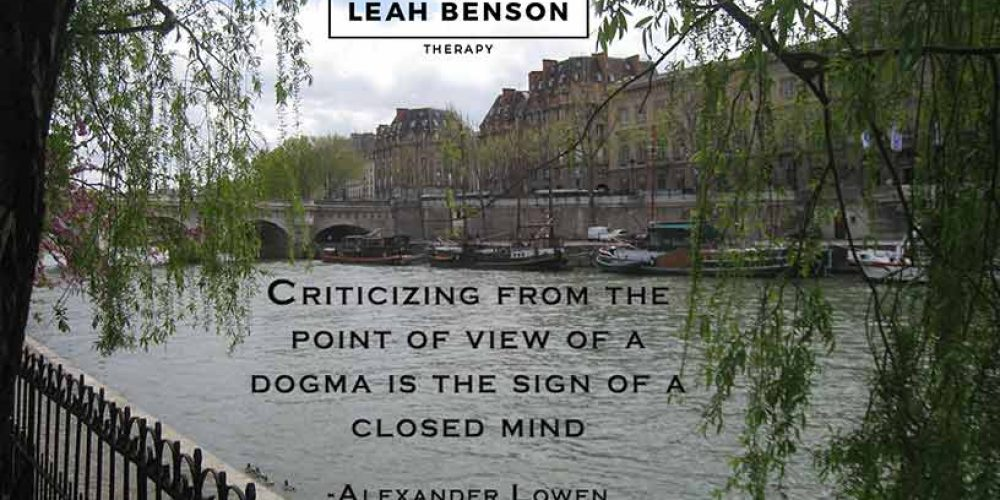 Photo of Seine River in Paris with boats and a bridge. Quote by Alexander Lowen,
