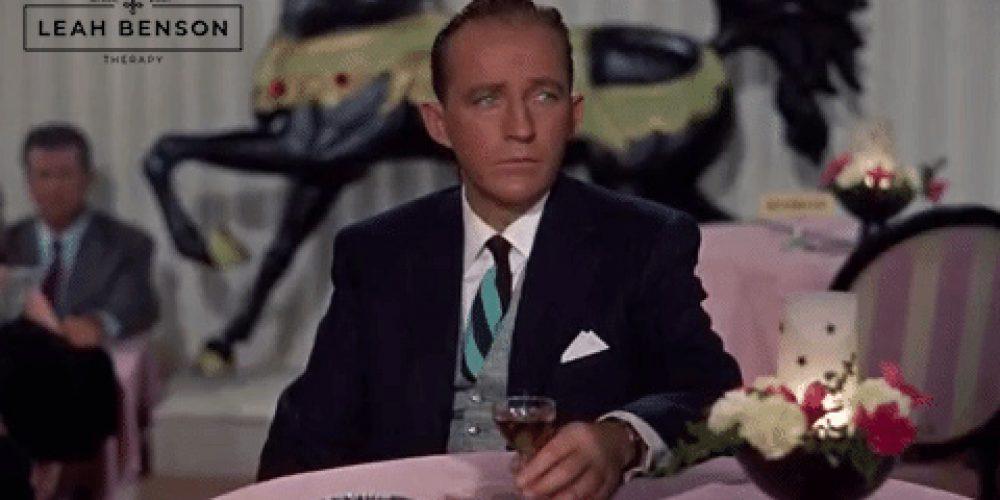 Bing Crosby at table