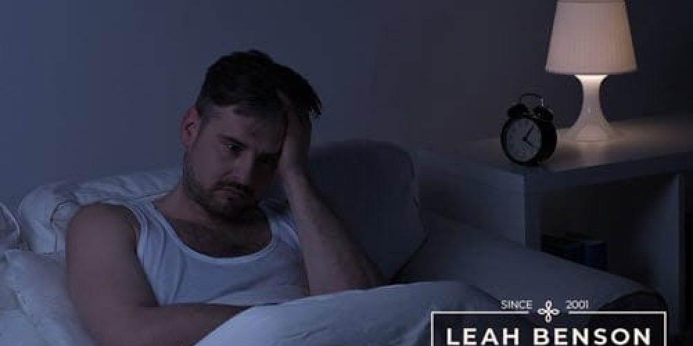 insomnia - sleepless man in bed at night